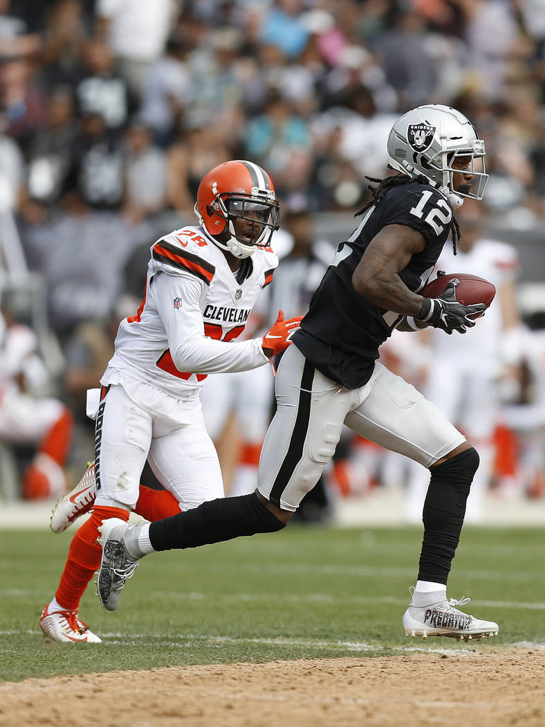 Oakland Raiders wide receiver Martavis Bryant (12) runs in front of Cleveland Browns defensive back E.J. Gaines (28) during an NFL football game in Oakland, Calif., Sunday, Sept. 30, 2018. (AP Pho ...