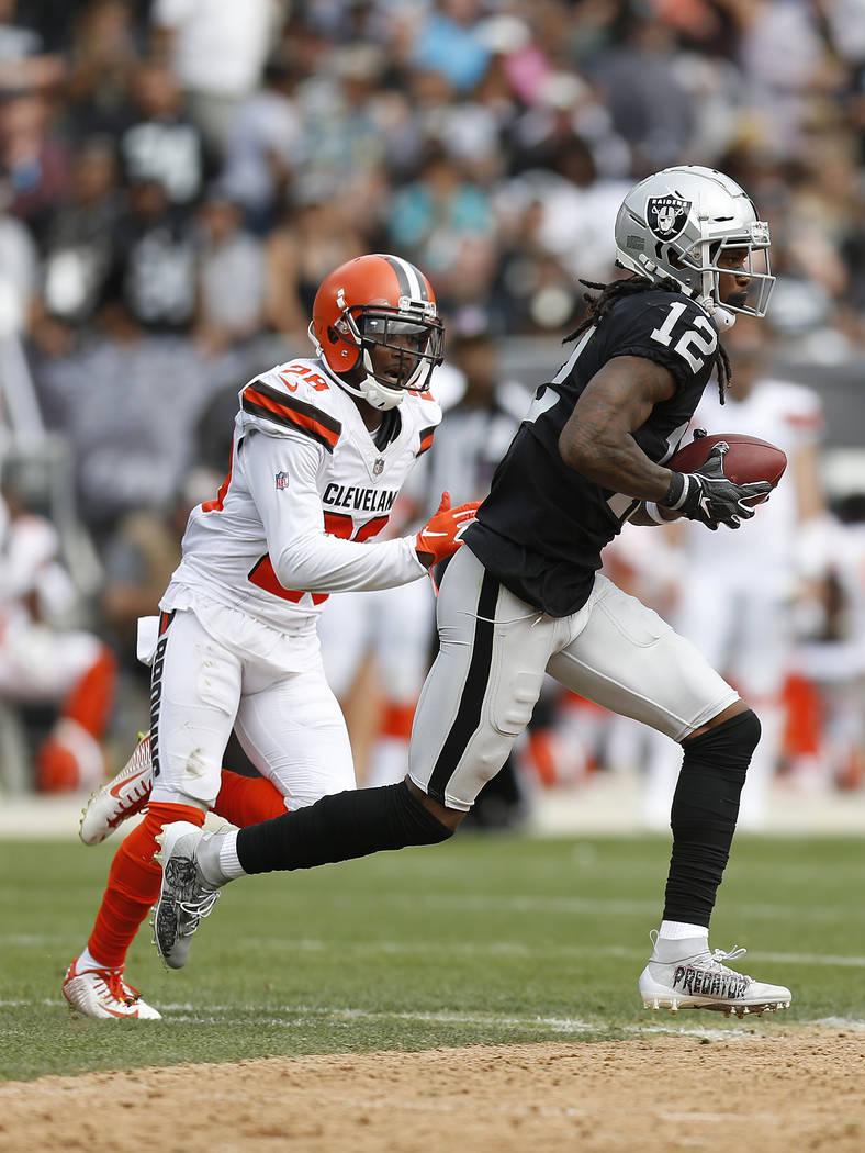 Oakland Raiders wide receiver Martavis Bryant (12) runs in front of  Cleveland Browns defensive 540451077