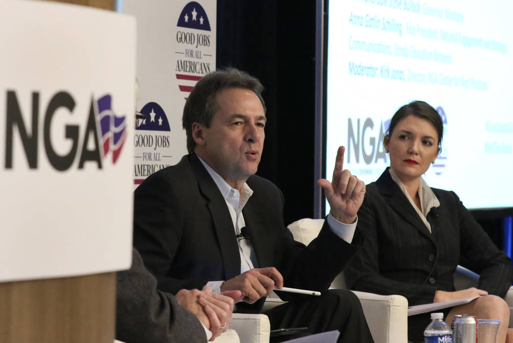 Montana Gov. Steve Bullock speaks as Anna Gatlin Schilling, vice president of National Engagement and Strategic Communications at Strada Education Network, looks on during a panel discus ...