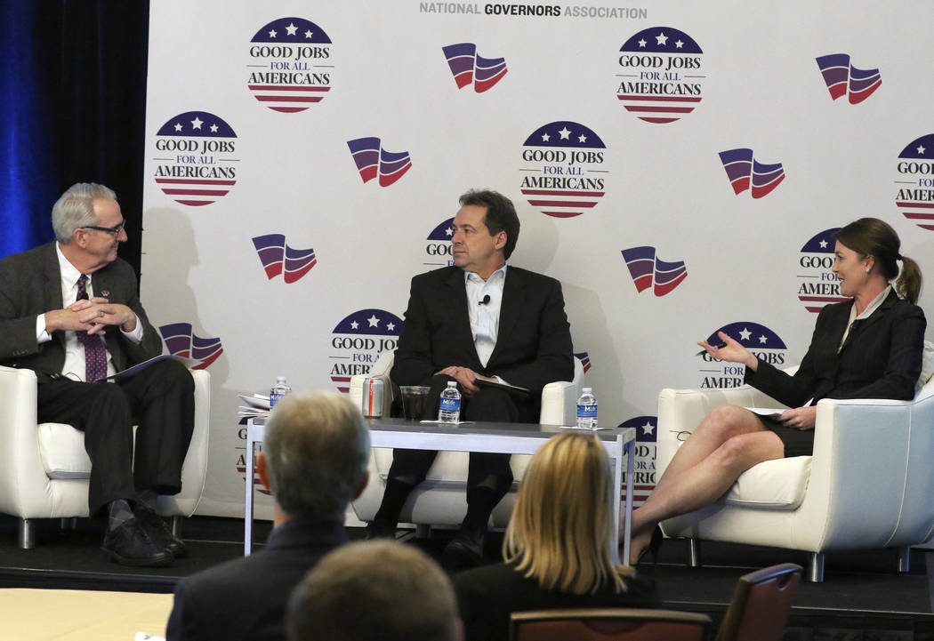 Moderator Kirk Jonas, director of the National Governors Association Center for Best Practices, left, Montana Gov. Steve Bullock and Anna Gatlin Schilling, vice president of National Eng ...