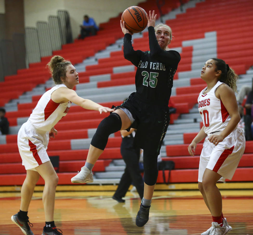 Palo Verde's Ashley Marushok (25) goes to the basket between Arbor View's Alina Oranchak, left, and Arbor View's Jada Willis (10) during the second half of a basketball game at Arbor View High Sch ...