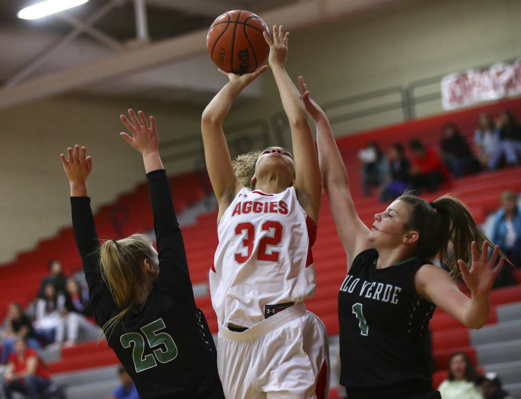 Arbor View's Amiya Lattomus (32) goes to the basket between Palo Verde's Ashley Marushok (25) and Alyssa Maillaro (1) during the first half of a basketball game at Arbor View High School in Las Ve ...