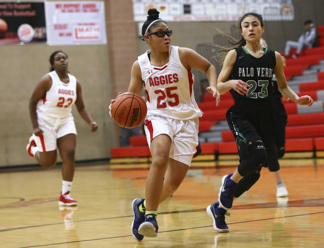Arbor View's Jessica Castro (25) drives to the basket against Palo Verde's Maya Bega (23) during the first half of a basketball game at Arbor View High School in Las Vegas on Wednesday, Dec. 5, 20 ...