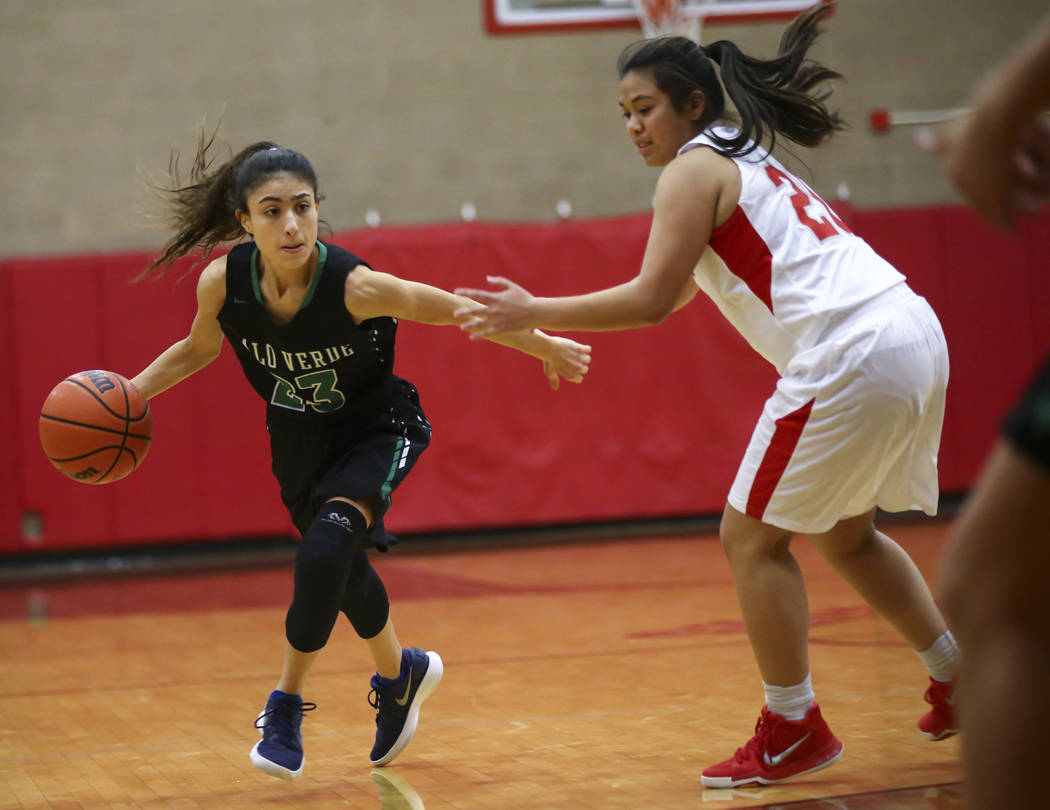 Palo Verde's Maya Bega (23) moves the ball around Arbor View's Tracy Abesamis during the second half of a basketball game at Arbor View High School in Las Vegas on Wednesday, Dec. 5, 2018. Chase S ...