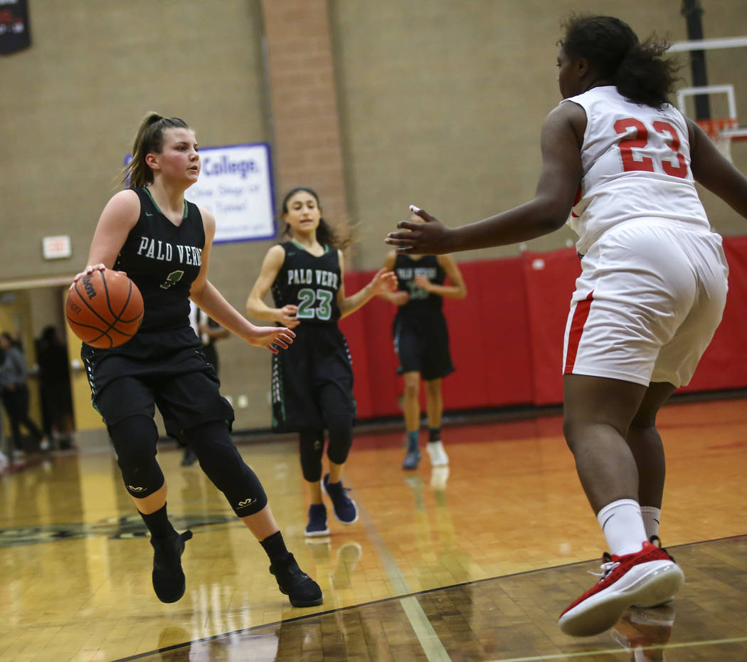 Palo Verde's Alyssa Maillaro (1) moves the ball around Arbor View's Naomi Hammonds (23) during the second half of a basketball game at Arbor View High School in Las Vegas on Wednesday, Dec. 5, 201 ...