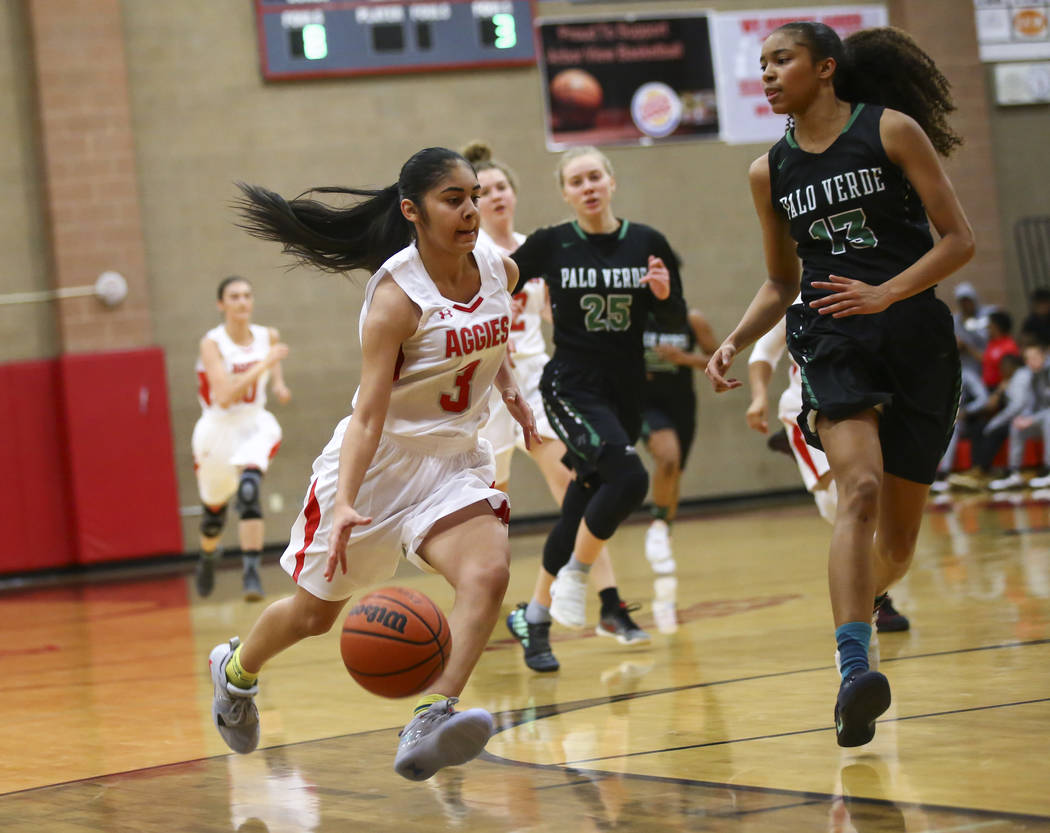 Arbor View's Janessa Adams (3) drives to the basket against Palo Verde's Kedrena Johnson (13) during the first half of a basketball game at Arbor View High School in Las Vegas on Wednesday, Dec. 5 ...