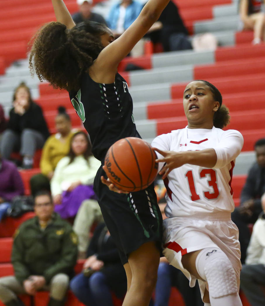Arbor View's Kendra Hill (13) moves the ball around Palo Verde's Kedrena Johnson during the first half of a basketball game at Arbor View High School in Las Vegas on Wednesday, Dec. 5, 2018. Chase ...
