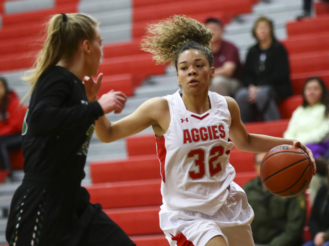 Arbor View's Amiya Lattomus (32) drives the ball around Palo Verde's Ashley Marushok (25) during the first half of a basketball game at Arbor View High School in Las Vegas on Wednesday, Dec. 5, 20 ...