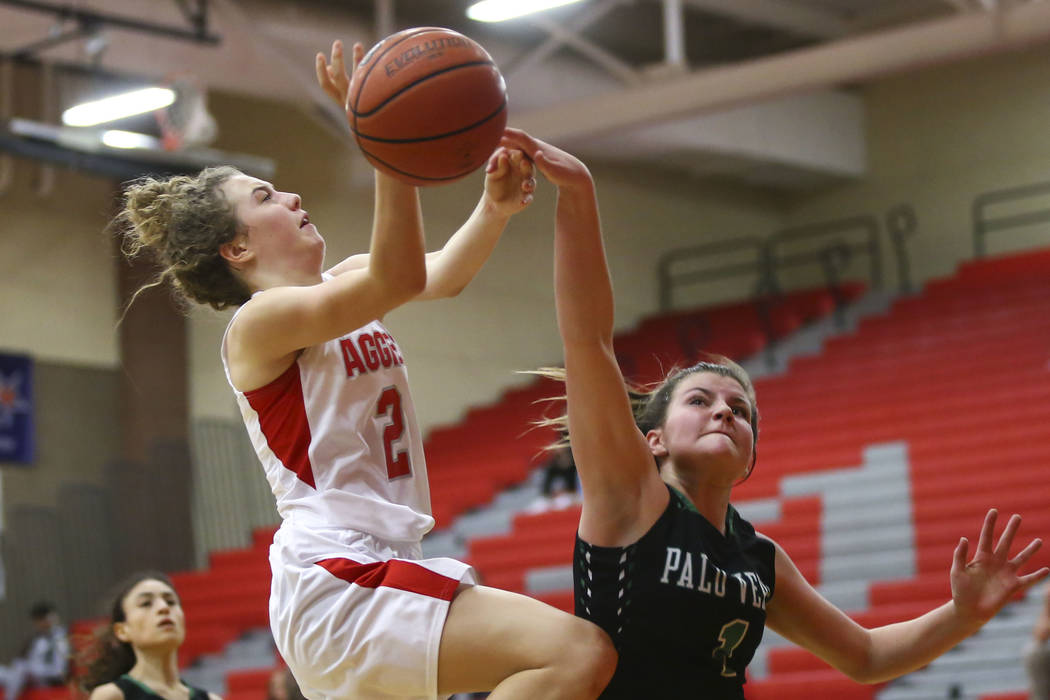 Arbor View's Alina Oranchak (2) gets fouled by Palo Verde's Alyssa Maillaro (1) during the first half of a basketball game at Arbor View High School in Las Vegas on Wednesday, Dec. 5, 2018. Chase ...