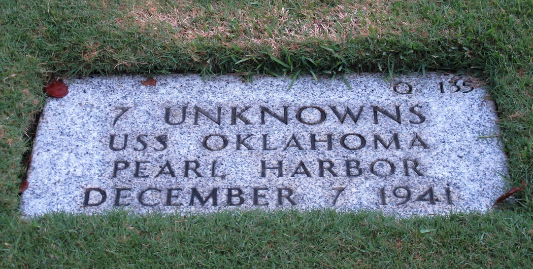 FILE - In this Dec. 5, 2012, file photo, the National Memorial Cemetery of the Pacific in Honolulu displays a gravestone identifying it as the resting place of seven unknown people from the USS Ok ...