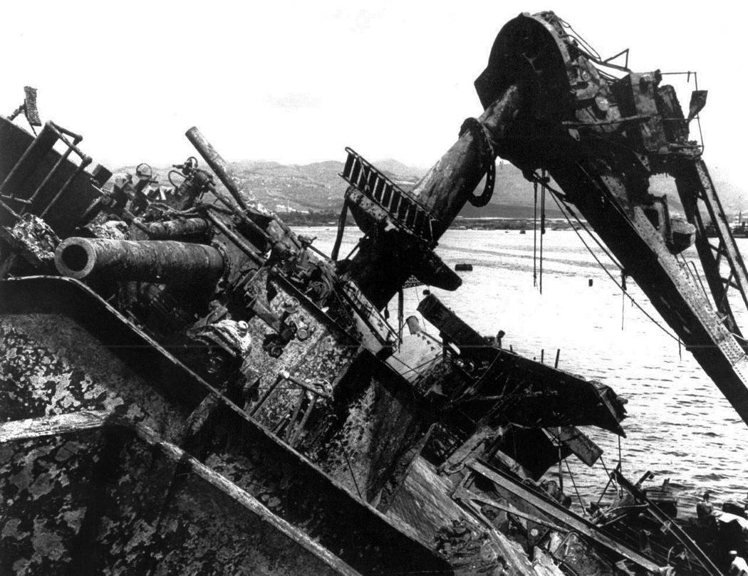 FILE - In this May 24, 1943 file photo, the capsized battleship USS Oklahoma is lifted out of the water at Pearl Harbor in Honolulu, Hawaii. More than 75 years after nearly 2,400 members of the U. ...