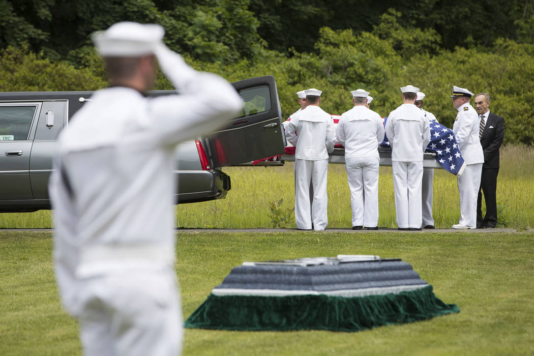 FILE - In this June 9, 2018, file photo, a casket containing the remains of U.S. Navy Seaman 1st Class Edward Slapikas, a Newport Twp., Pa. native killed while serving aboard the USS Oklahoma in t ...