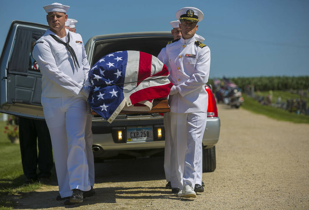 FILE - In this July 7, 2018 file photo, U.S. Navy sailors remove the casket with the remains of Seaman First Class Leon Arickx from a hearse at Sacred Heart Cemetery where they will be put to rest ...