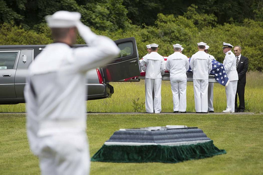 In this June 9, 2018, file photo, a casket containing the remains of U.S. Navy Seaman 1st Class Edward Slapikas, a Newport Twp., Pa. native killed while serving aboard the USS Oklahoma in the Japa ...