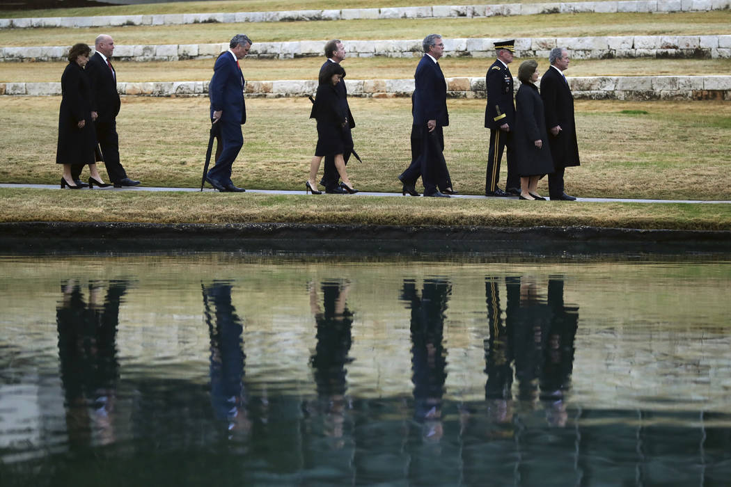 Family members follow the flag-draped casket of former President George H.W. Bush for burial at the George H.W. Bush Presidential Library and Museum Thursday, Dec. 6, 2018, in College Station, Tex ...