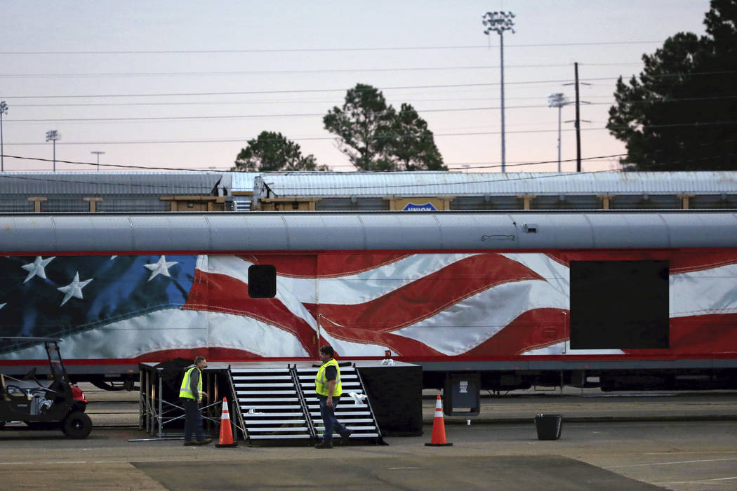 Workers prepare for a departure ceremony of the casket of former President George H.W. Bush at Union Pacific Westfield auto facility Thursday, Dec. 6, 2018, in Spring. The Plexiglass door, right, ...