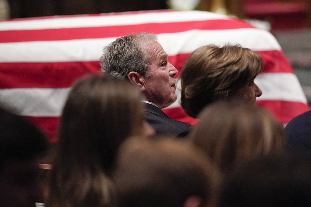 Former President George W. Bush and Laura Bush listen during a funeral service for former President George H.W. Bush at St. Martin's Episcopal Church Thursday, Dec. 6, 2018, in Houston. (AP Photo/ ...