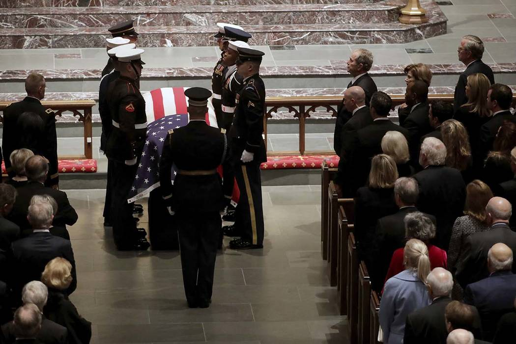 The flag-draped casket of former President George H.W. Bush is carried by a joint services military honor guard during a funeral for former President George H.W. Bush at St. Martin's Episcopal Chu ...