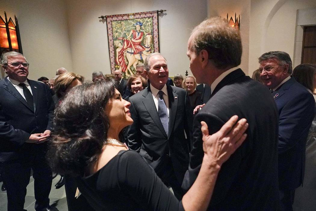 Former President George W. Bush and Laura Bush talk with Neil Bush and his wife Maria, front left, after a funeral service for former President George H.W. Bush at St. Martin's Episcopal Church Th ...