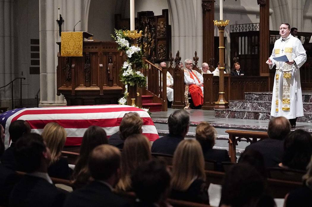 Rev. Russell J. Levenson Jr., speaks during a funeral service for former President George H.W. Bush at St. Martin's Episcopal Church Thursday, Dec. 6, 2018, in Houston. (AP Photo/David J. Phillip, ...