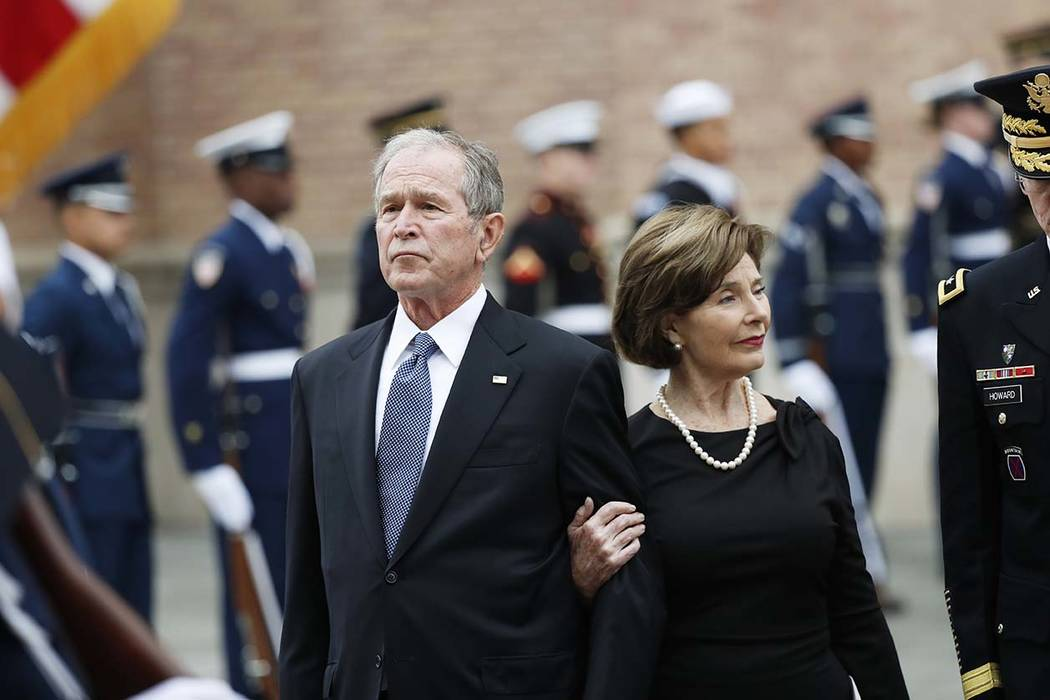 Former President George W. Bush and his wife, Laura Bush, leave St. Martin's Episcopal Church in Houston after the funeral service for his father, former President George H.W. Bush on Thursday, De ...