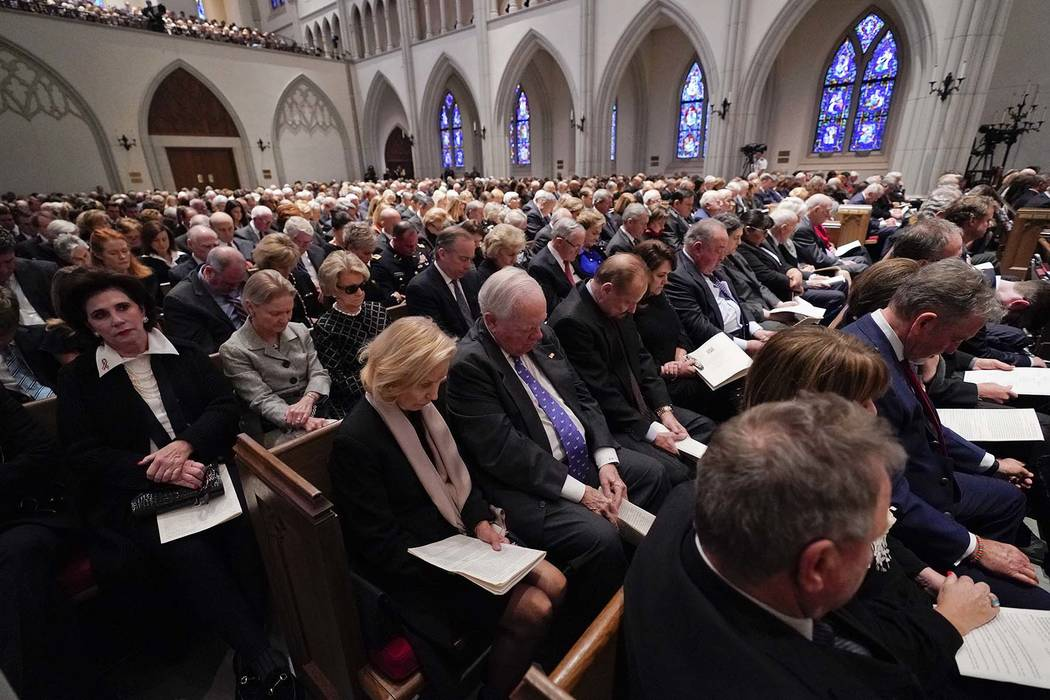 Family members and friends pray during a funeral service for former President George H.W. Bush at St. Martin's Episcopal Church Thursday, Dec. 6, 2018, in Houston. (AP Photo/David J. Phillip, Pool)