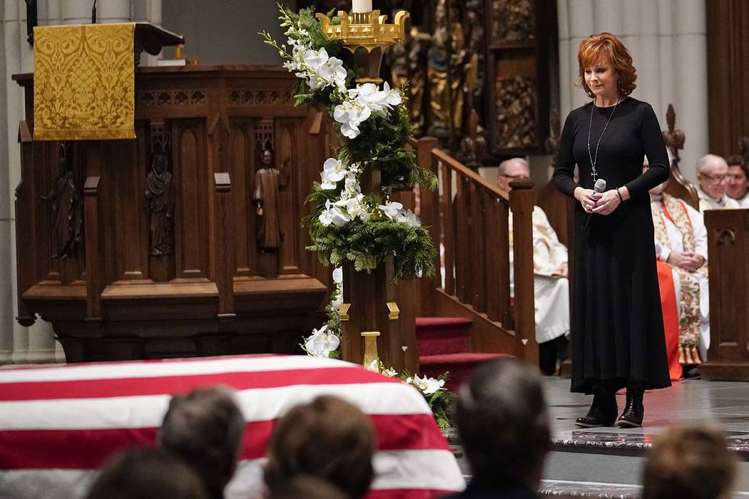 "Reba McEntire sings ""The Lord's Prayer"" during a funeral service for former President George H.W. Bush at St. Martin's Episcopal Church Thursday, Dec. 6, 2018, in Houston. (AP Photo/Davi ..."