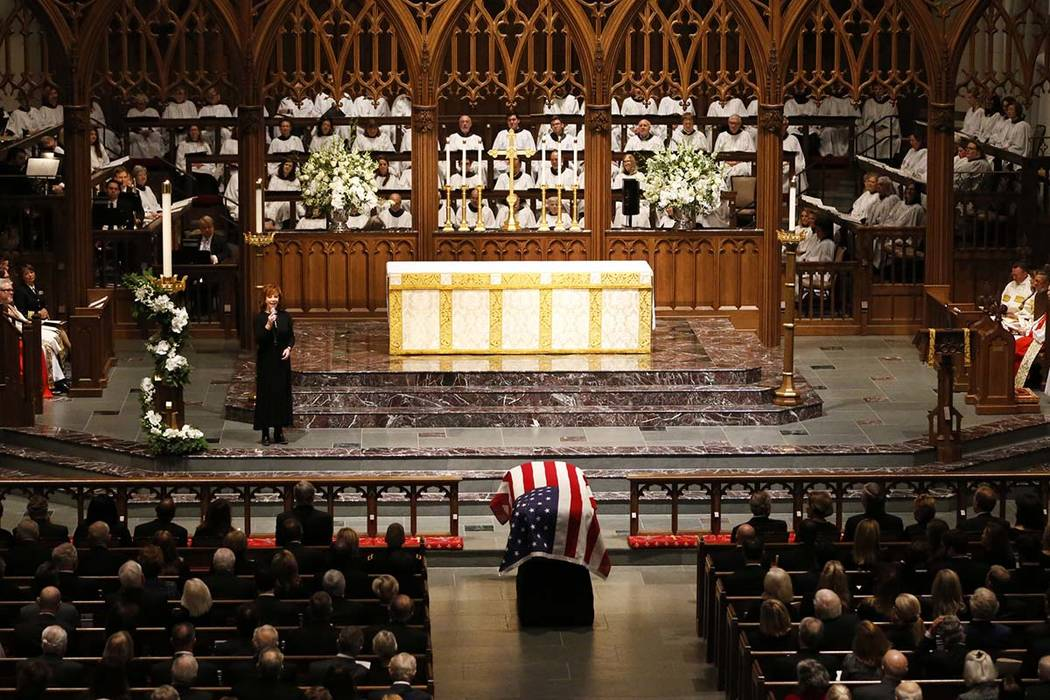"Reba McEntire sings ""The Lord's Prayer"" during a funeral service for former President George H.W. Bush at St. Martin's Episcopal Church Thursday, Dec. 6, 2018, in Houston. (AP Photo/Mark ..."