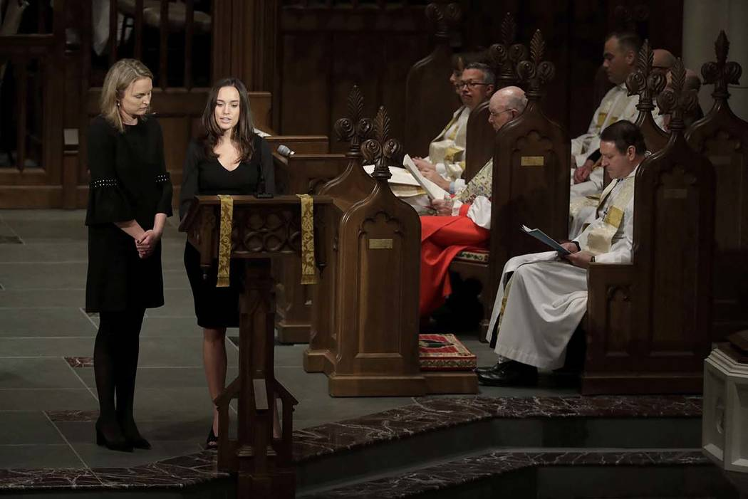 Granddaughters Nancy Ellis LeBlond Sosa, left, and Georgia Grace Koch read scripture during a funeral for former President George H.W. Bush at St. Martin's Episcopal Church Thursday, Dec. 6, 2018, ...