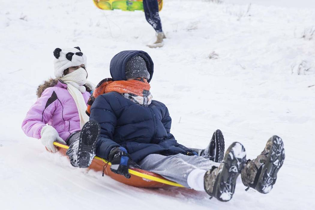 Natalie Anderson, left, 12, and brother Joey, 13, ride their sled at Lee Meadows on Friday, Nov. 30, 2018, outside Lee Canyon, in Las Vegas. (Benjamin Hager/Las Vegas Review-Journal)