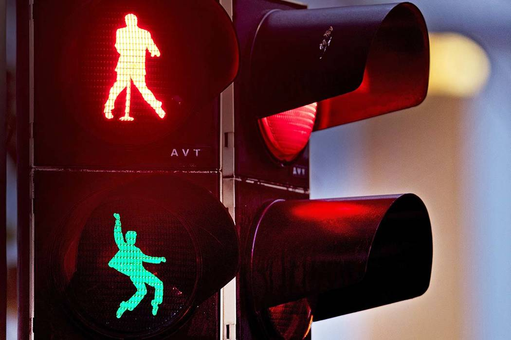 Walking figures depicting Elvis Presley appear on a traffic light switching from green to red in Friedberg near Frankfurt, Germany, Thursday, Dec. 6, 2018. Presley served in Friedberg from October ...
