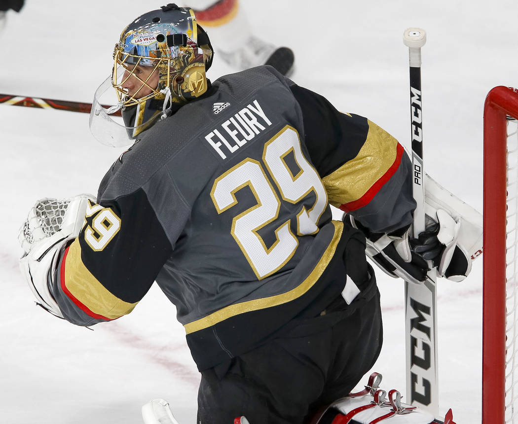 Vegas Golden Knights goaltender Marc-Andre Fleury (29) keeps his eye on a incoming slap shot during the first period of an NHL hockey game between the Vegas Golden Knights and the Calgary Flames a ...