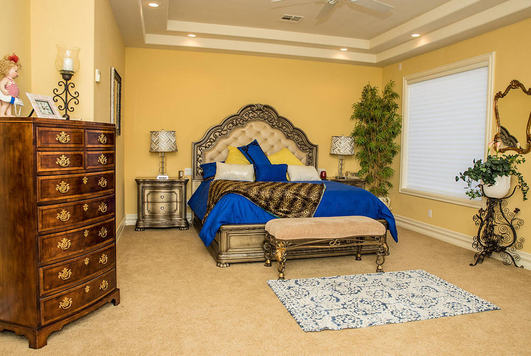 The home's downstairs master suite. (Tonya Harvey Real Estate Millions)