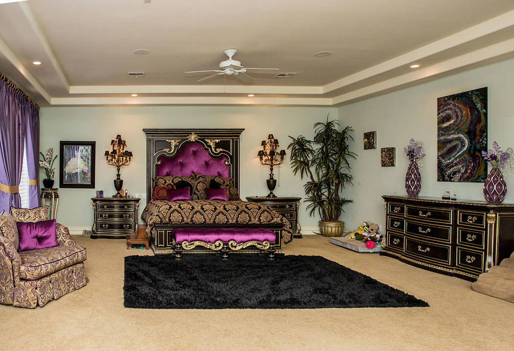 The home's second master suite is decked out in purple. (Tonya Harvey Real Estate Millions)