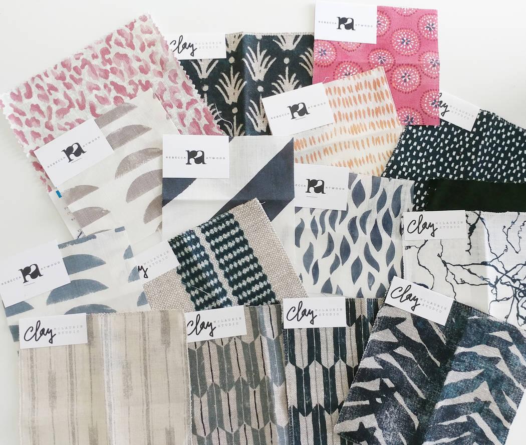 Daniella Villamil, the owner of Daniella Villamil Interior Design, displays some of the fabric samples she got from Nicky Rising. (Daniella Villamil)