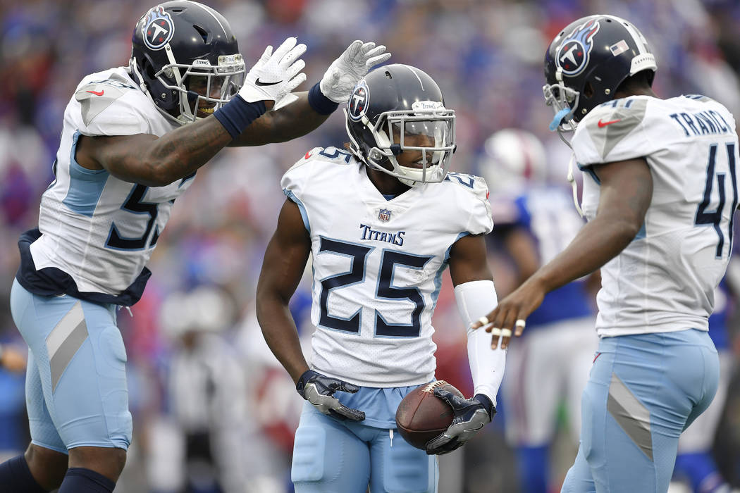Tennessee Titans cornerback Adoree' Jackson (25) is congratulated bylinebacker Daren Bates (53) and safety Brynden Trawick (41) after an interception during the second half of an NFL football game ...