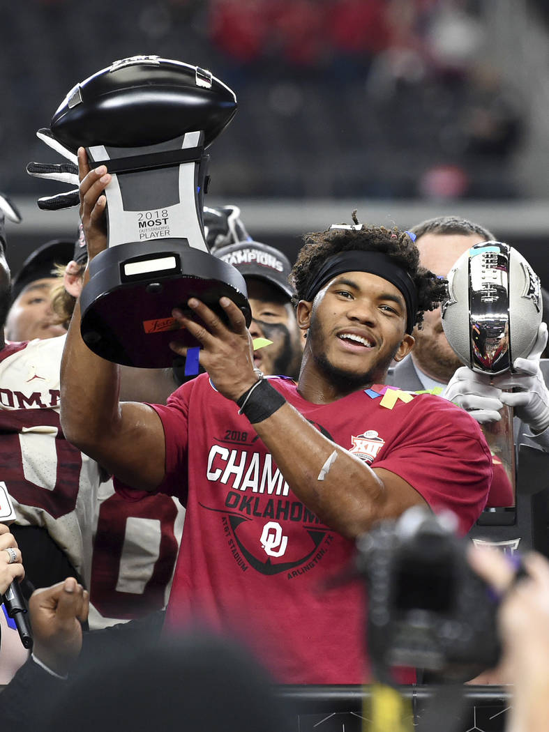 In this Dec. 1, 2018, file photo, Oklahoma quarterback Kyler Murray hoists the Most Outstanding Player trophy after beating Texas 39-27 in the Big 12 Conference championship NCAA college football ...