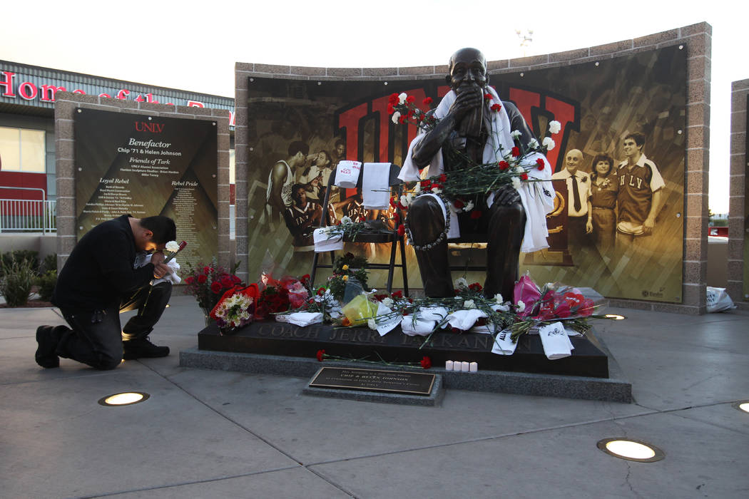 UNLV student Cesar Castillo says a prayer at a statue of Jerry Tarkanian during a vigil for the former UNLV basketball coach who passed away Wednesday, Feb. 11, 2015. (Sam Morris/Las Vegas Review ...