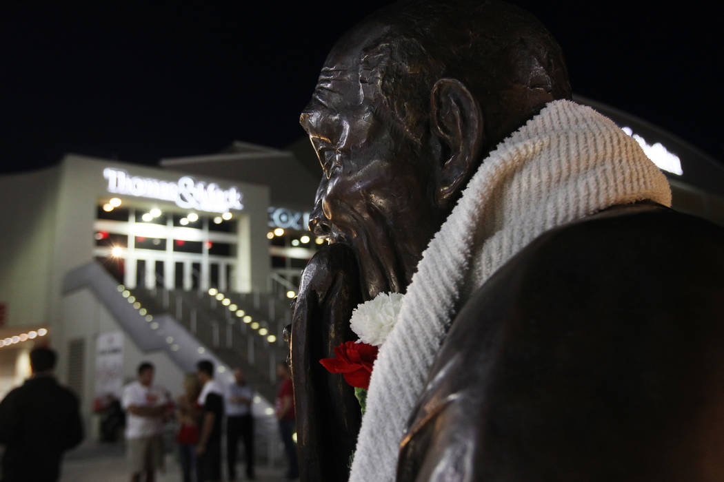 A statue of Jerry Tarkanian is draped with towels and carnations during a vigil for the former UNLV basketball coach who passed away Wednesday, Feb. 11, 2015. (Sam Morris/Las Vegas Review-Journal)