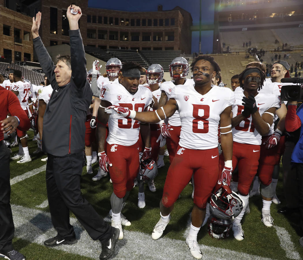Washington State head coach Mike Leach, front, acknowledges the crowd as his team assembles to sing the school song after an NCAA college football game against Colorado Saturday, Nov. 10, 2018, in ...