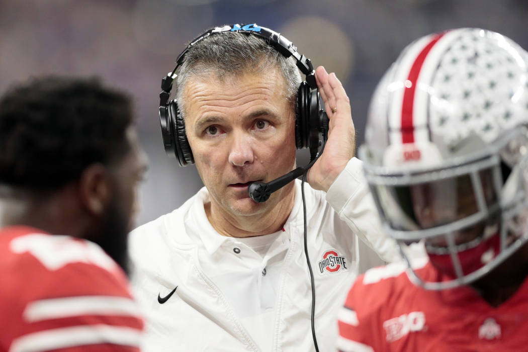 Ohio State head coach Urban Meyer listens on a head set on the sideline during the first half of the Big Ten championship NCAA college football game against Northwestern, Saturday, Dec. 1, 2018, i ...
