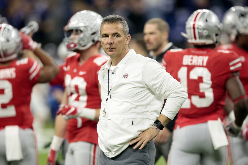 Ohio State head coach Urban Meyer watches during his team warm up before the Big Ten championship NCAA college football game against Northwestern, Saturday, Dec. 1, 2018, in Indianapolis. (AP Phot ...