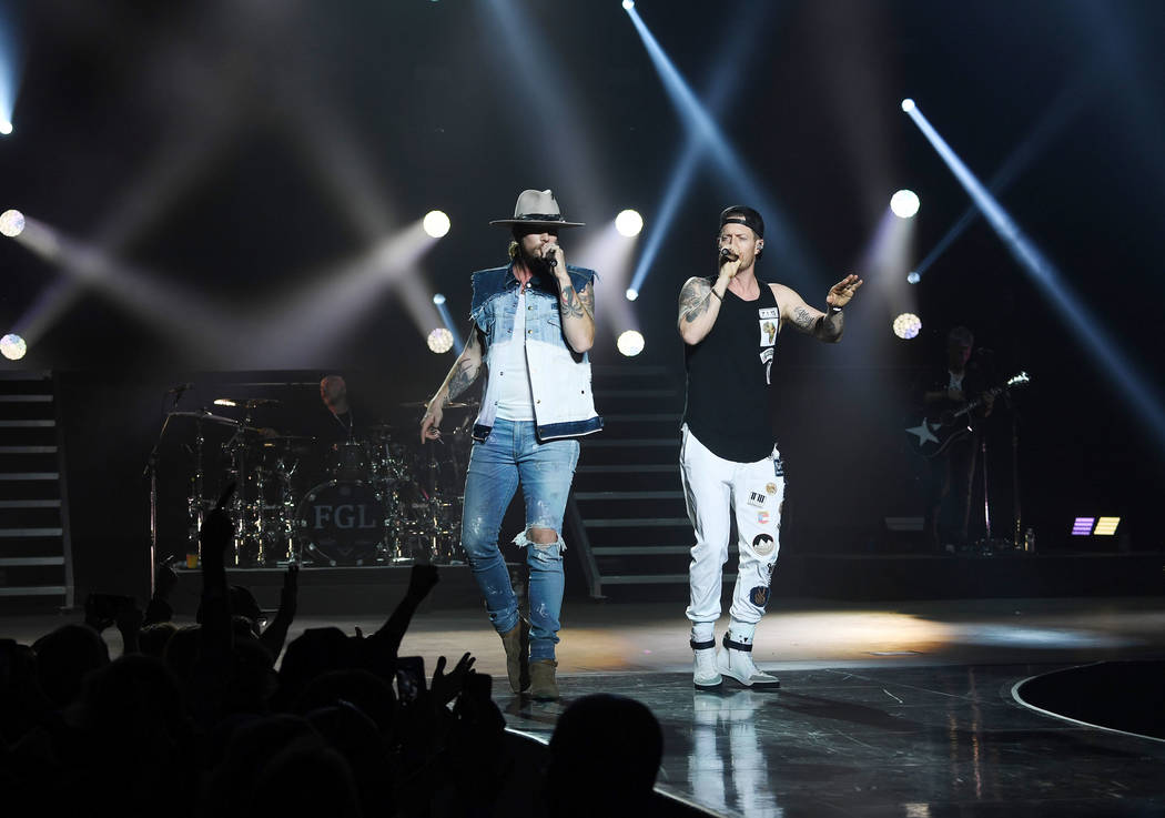 American country music duo Brian Kelley (L) and Tyler Hubbard perform at Zappos Theater at Planet Hollywood Resort & Casino on December 5, 2018 in Las Vegas, Nevada. (Photo by Denise Truscello/Wi ...