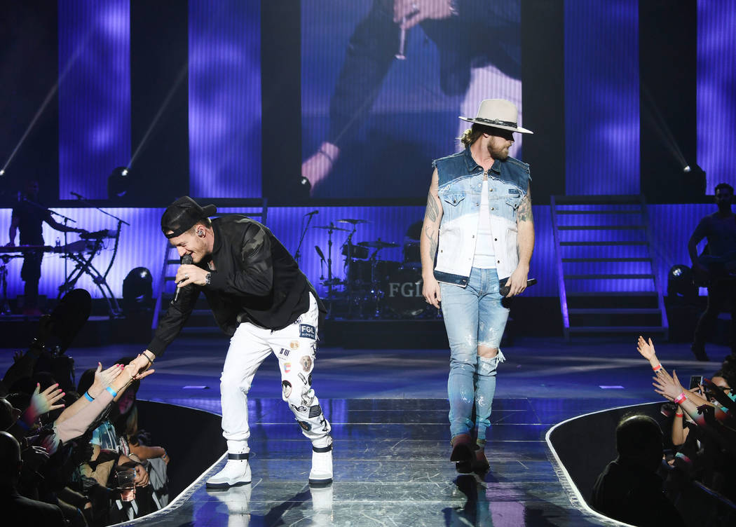 American country music duo Tyler Hubbard (L) and Brian Kelley (R) of Florida Georgia Line perform at Zappos Theater at Planet Hollywood Resort & Casino on December 5, 2018 in Las Vegas, Nevada. ( ...