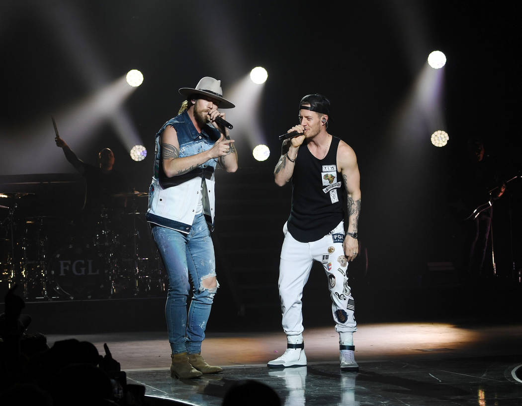 American country music duo Brian Kelley (L) and Tyler Hubbard (R) of Florida Georgia Line perform at Zappos Theater at Planet Hollywood Resort & Casino on December 5, 2018 in Las Vegas, Nevada. ( ...