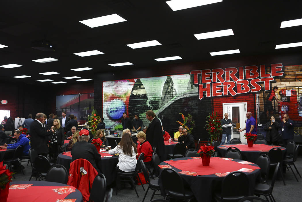 Family members, employees and friends of Jerry Herbst attend a public memorial service in his memory at the Terrible Herbst Employment Center in Las Vegas on Thursday, Dec. 6, 2018. Herbst helped ...