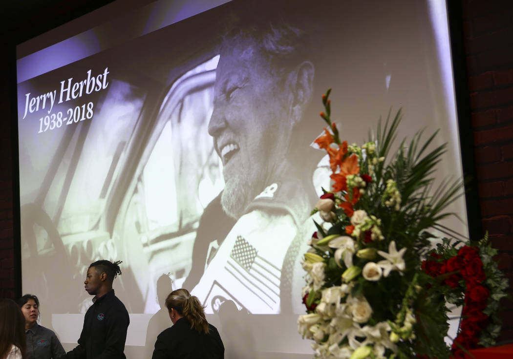A photo of Jerry Herbst is displayed during a slideshow at a public memorial service in his memory at the Terrible Herbst Employment Center in Las Vegas on Thursday, Dec. 6, 2018. Herbst helped hi ...