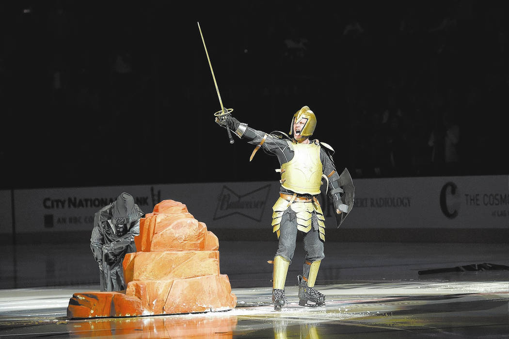 A sword is pulled from a stone as part of the Vegas Golden Knights pregame before taking on the St. Louis Saturday, October 21, 2017, at T-Mobile Arena in Las Vegas. The Knights won the game 3-2 i ...