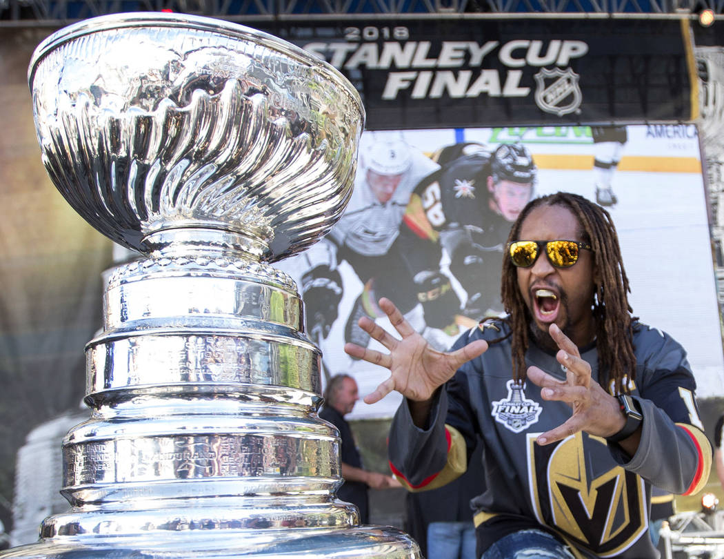 American rapper Lil Jon poses with the Stanley Cup before Game 1 of the NHL hockey Stanley Cup Finals between the Vegas Golden Knights and the Washington Capitals outside T-Mobile Arena in Las Veg ...