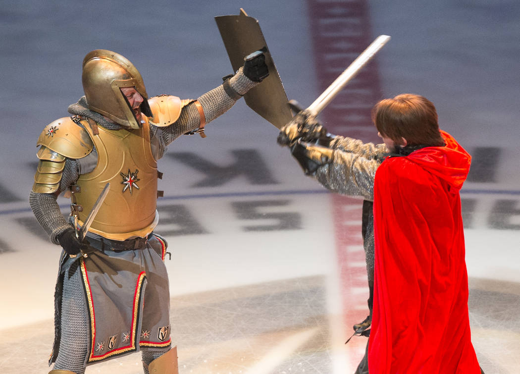 The Golden Knight battles the Capitals villain before the start of Game 2 of the NHL Stanley Cup Final between the Golden Knights and Washington Capitals on Wednesday, May 30, 2018, in Las Vegas. ...